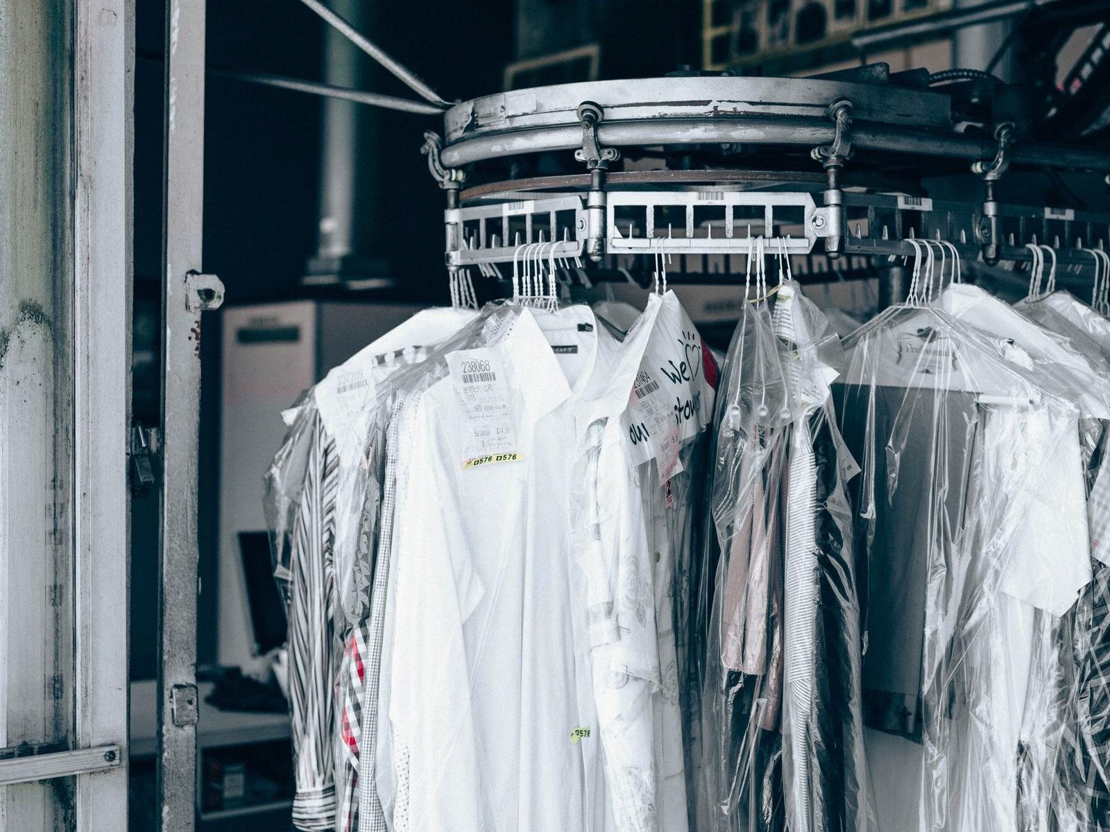 Clothes on dry cleaners rack