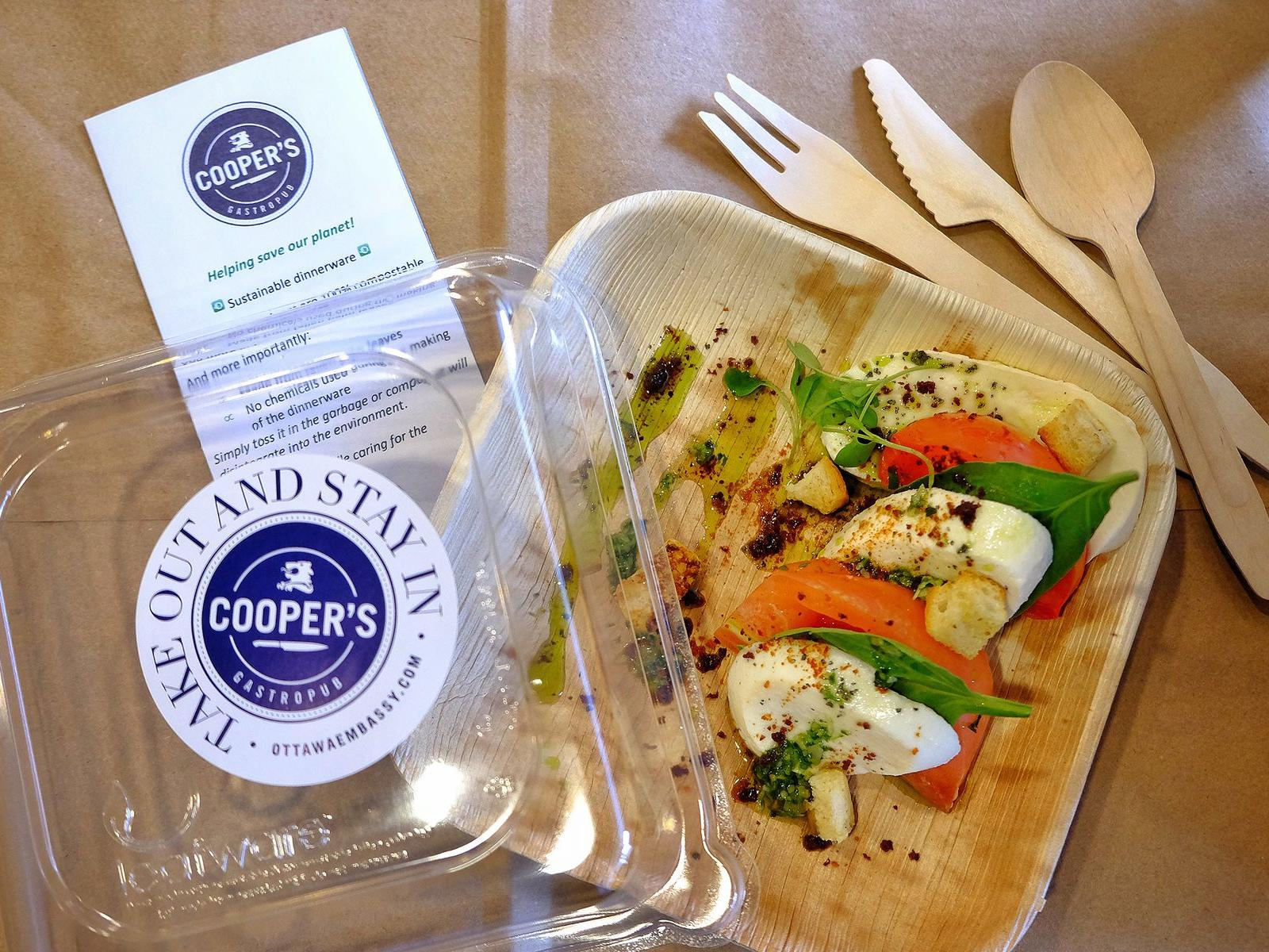 take out box with a caprese salad