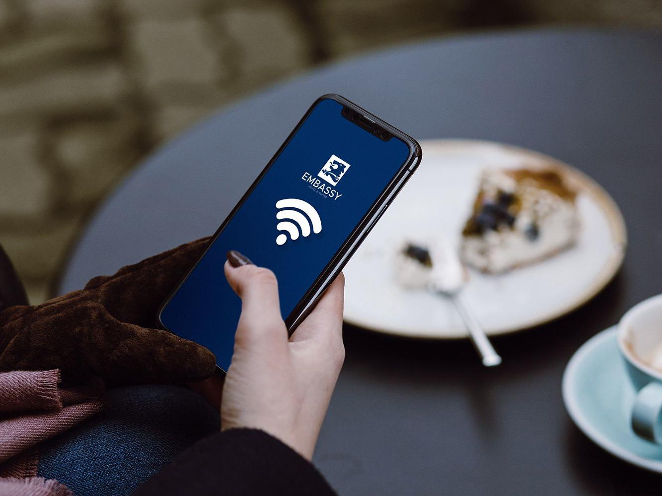 woman holding phone with wifi signal