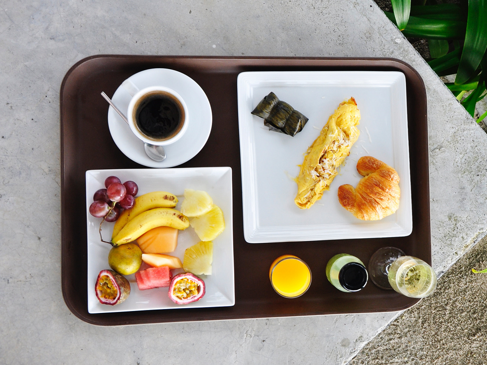 a tray of fruit and breakfast