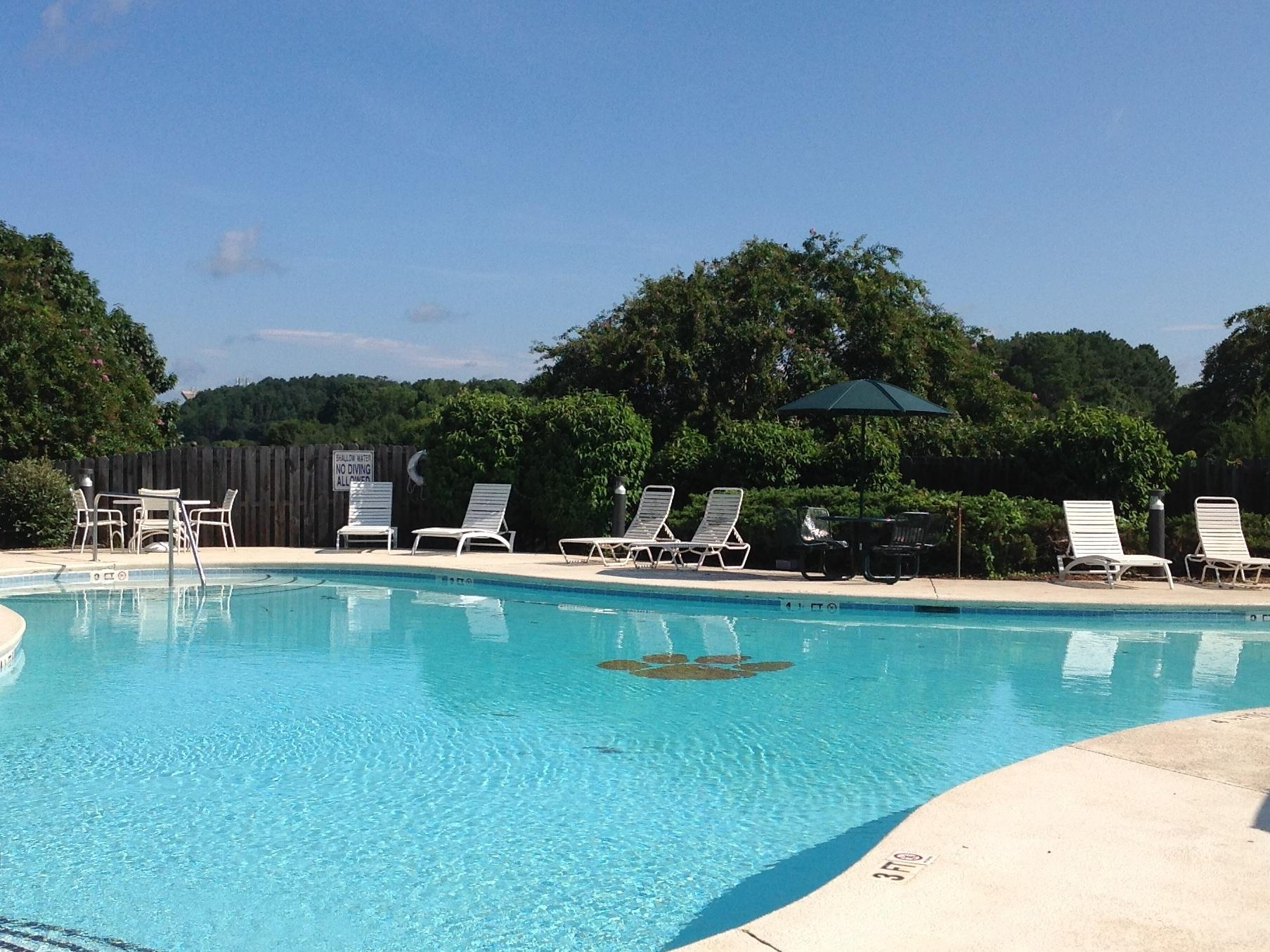 View of pool and chairs