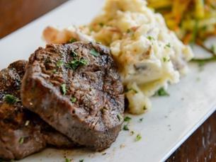 Steak and mashed potatoes on plate