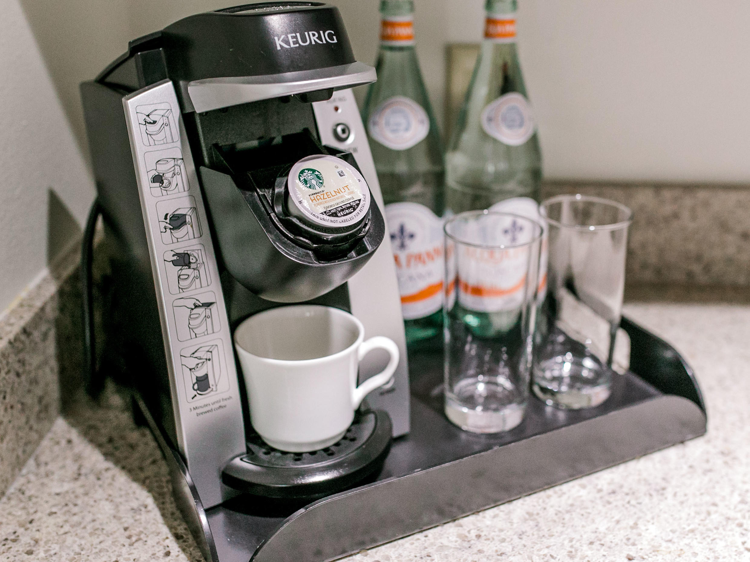 Keurig Coffe System with kcup, coffee mug, and water