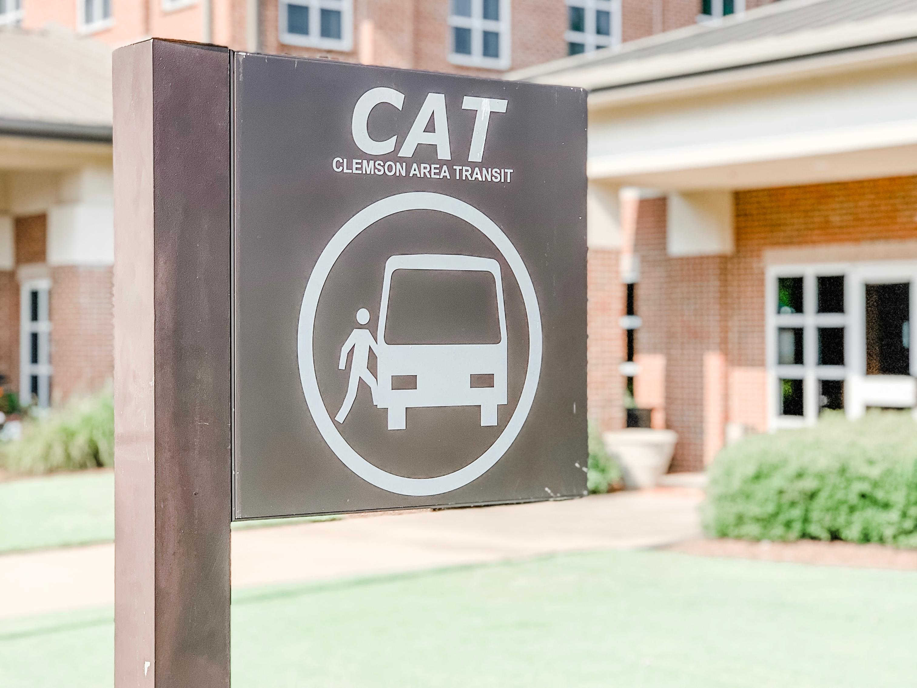 CATbus sign to show Stop in front of hotel building