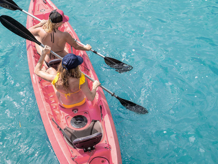 two women kayaking in ocean