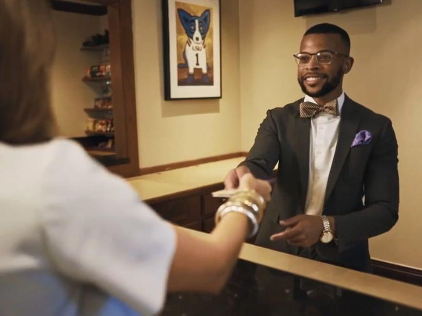 Concierge greeting guest at Cook Hotel