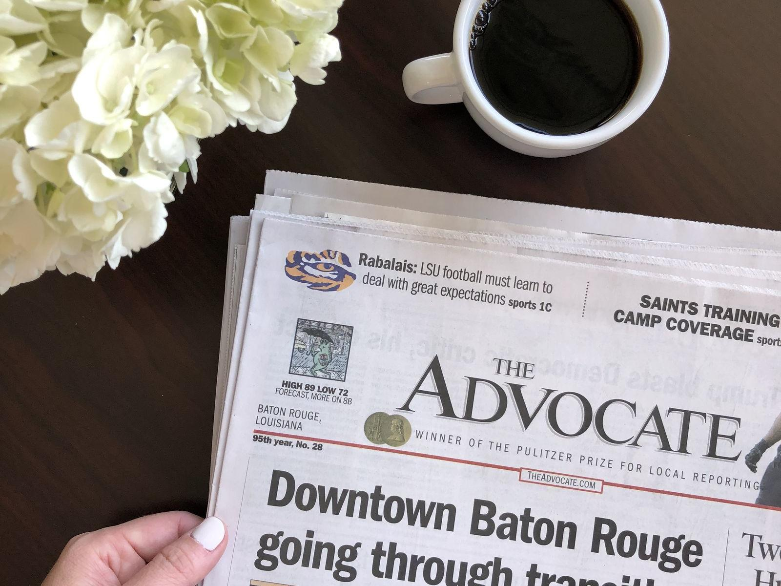 The Advocate newspaper and cup of coffee