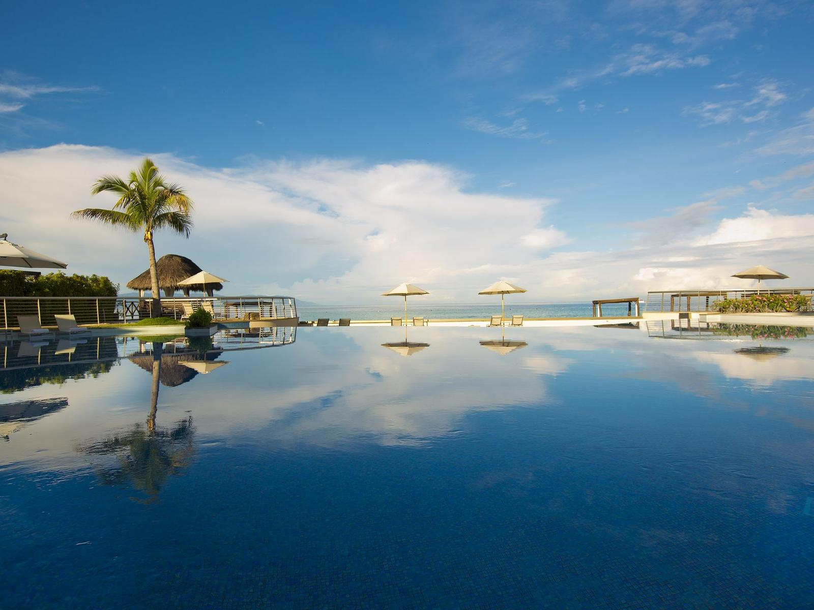 Infinity Pool with Beach in the Background