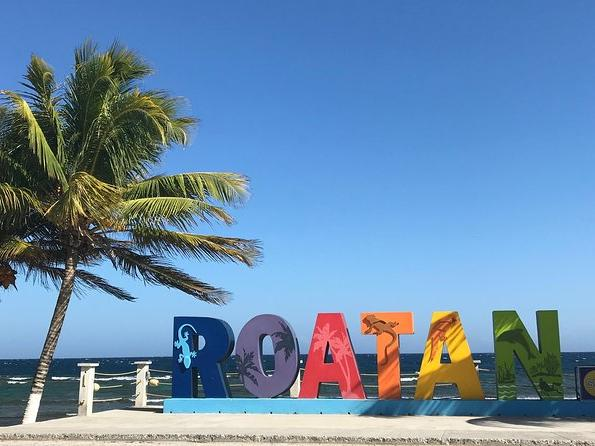 ROATAN letters near beach