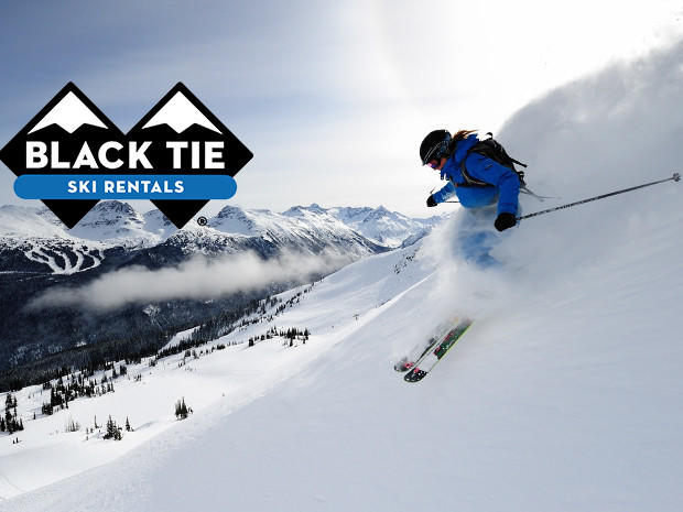 Skiier with logo for Black Tie Ski Rentals