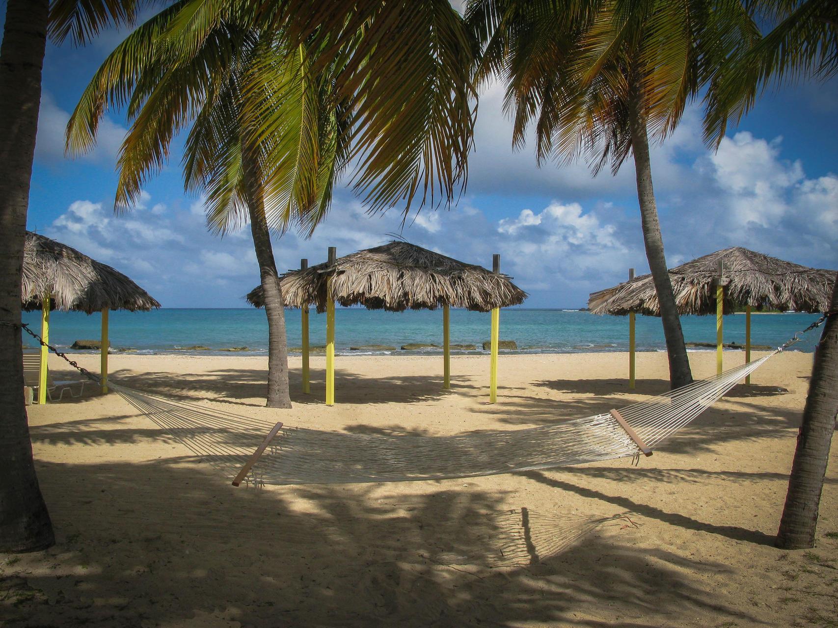 Hammock Tiki in the sea shore by beach at Tamarind Reef Resort