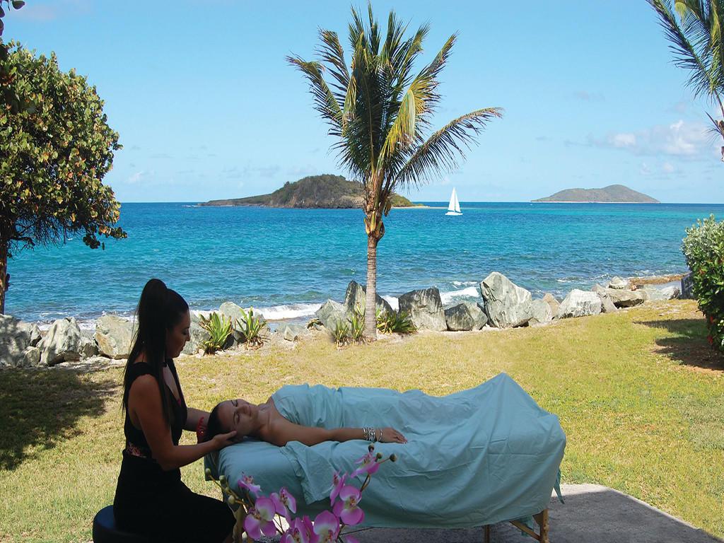Beach massage by the beach at Tamarind Reef Resort