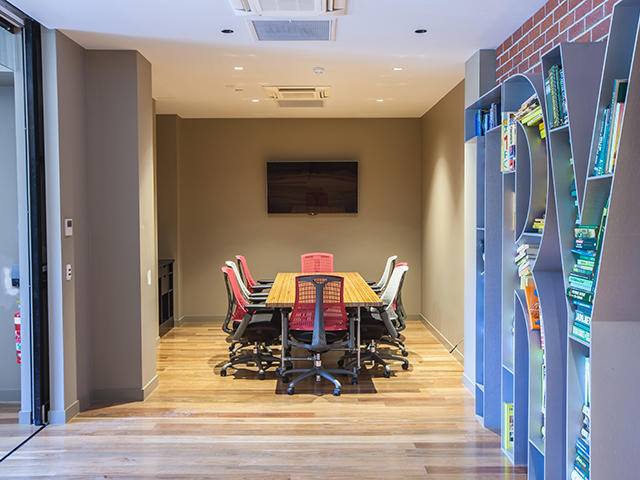 Small meeting space for 12 in a boardroom style layout