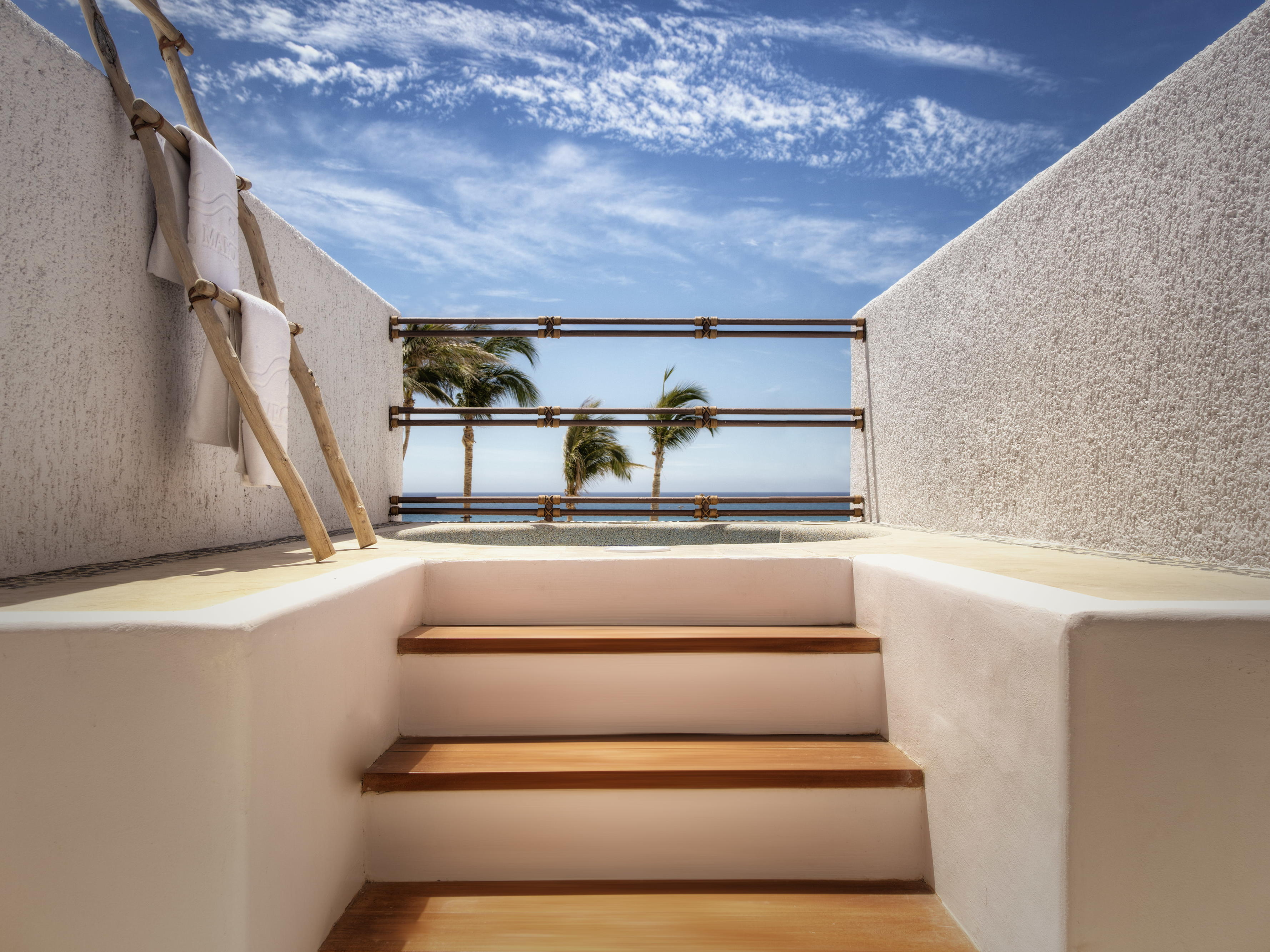 a staircase leading to a beachfront