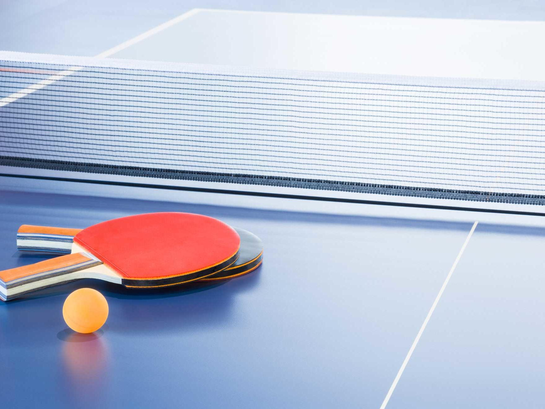 Rackets and ball on the blue tennis table at Silverwater Resort