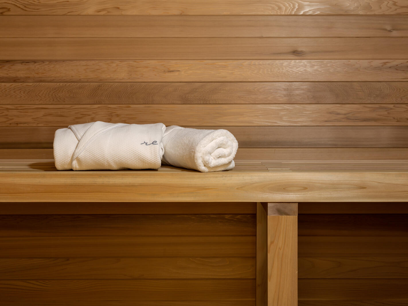 robe and towel folded on sauna bench
