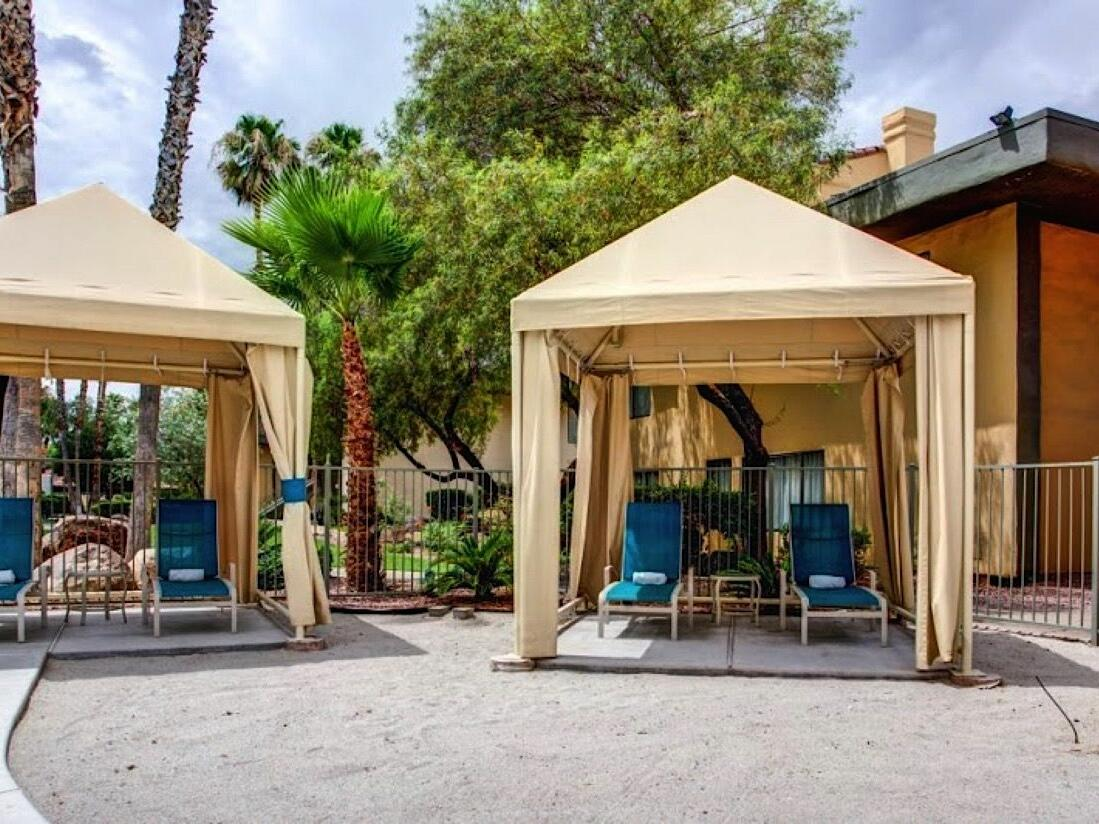 Poolside cabanas and towel service at the Alexis Park Resort