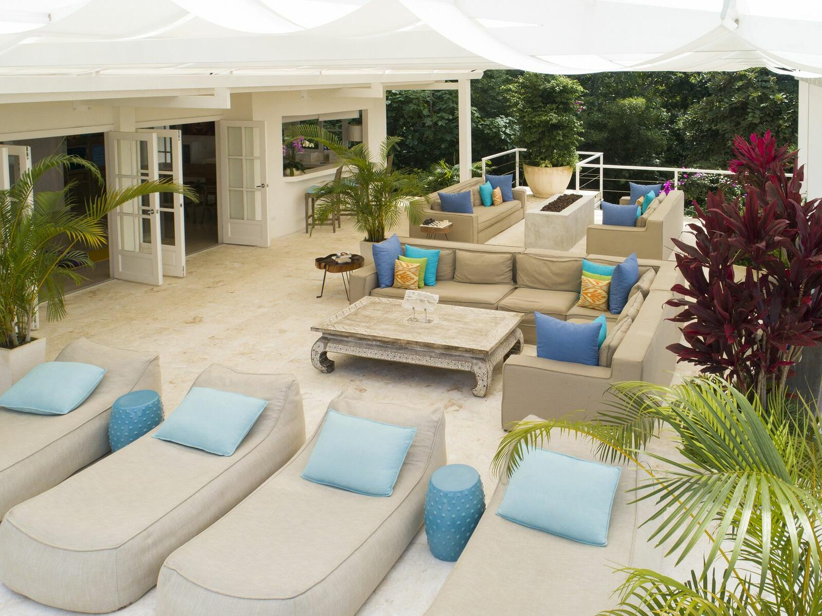 terrace with lounge chairs and sofas