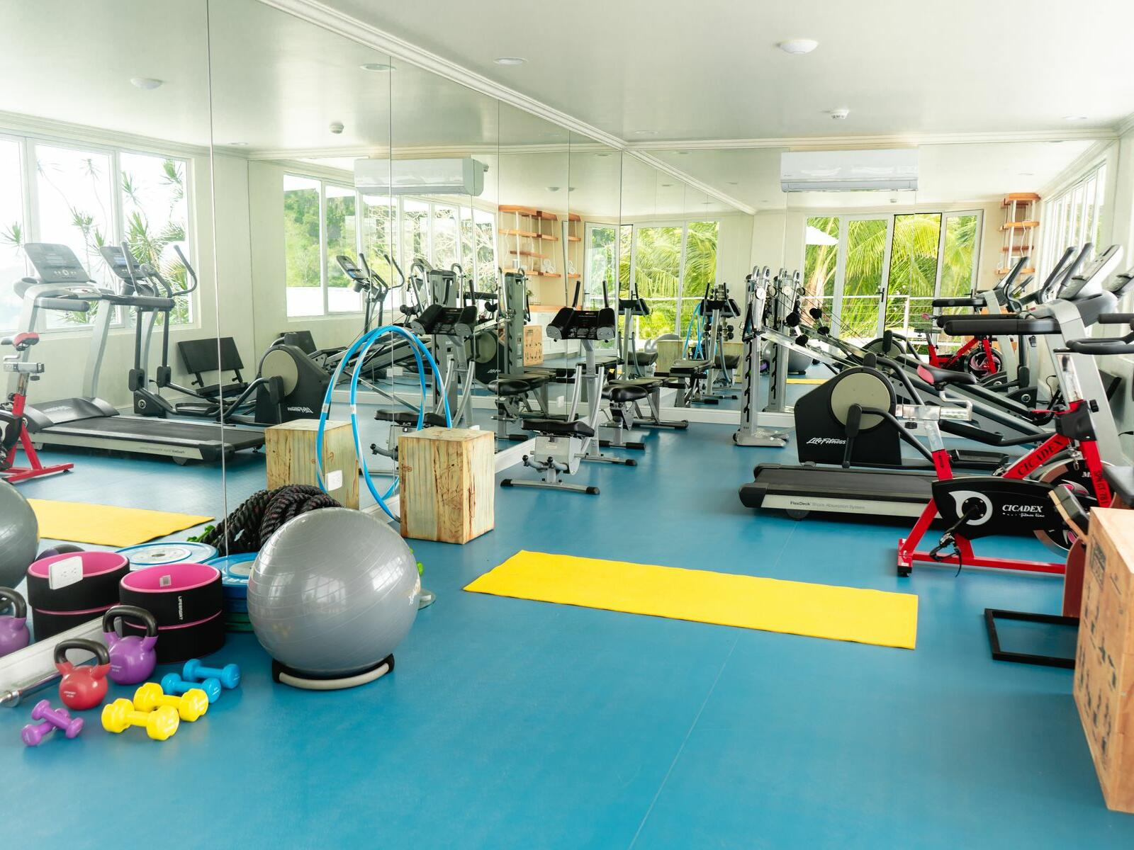 fitness center with assorted equipment