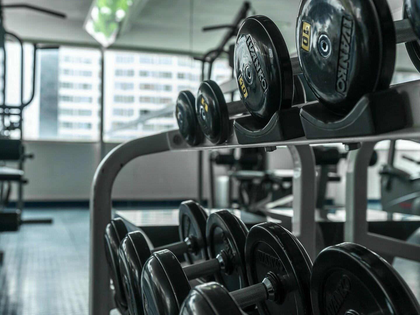 Dumbells racked accordingly in the gym at Dream Midtown NYC