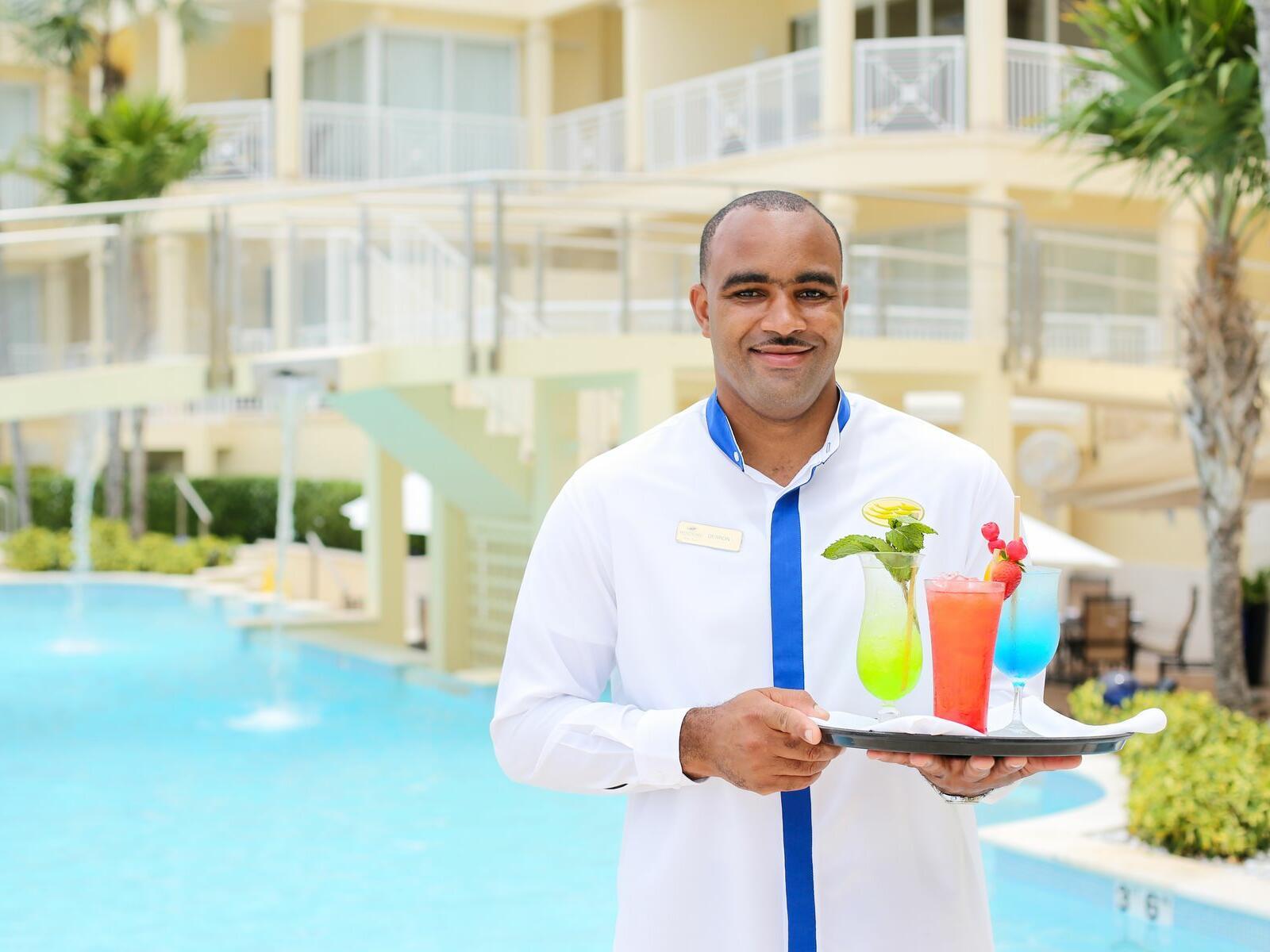 A Butler delivering drinks at Windsong Resort On The Reef