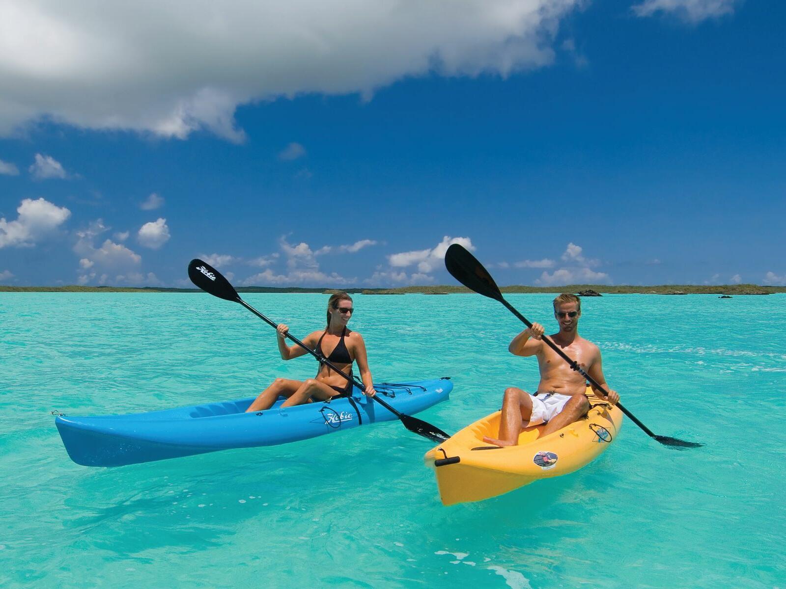 Couple Kayaking near Windsong Resort On The Reef
