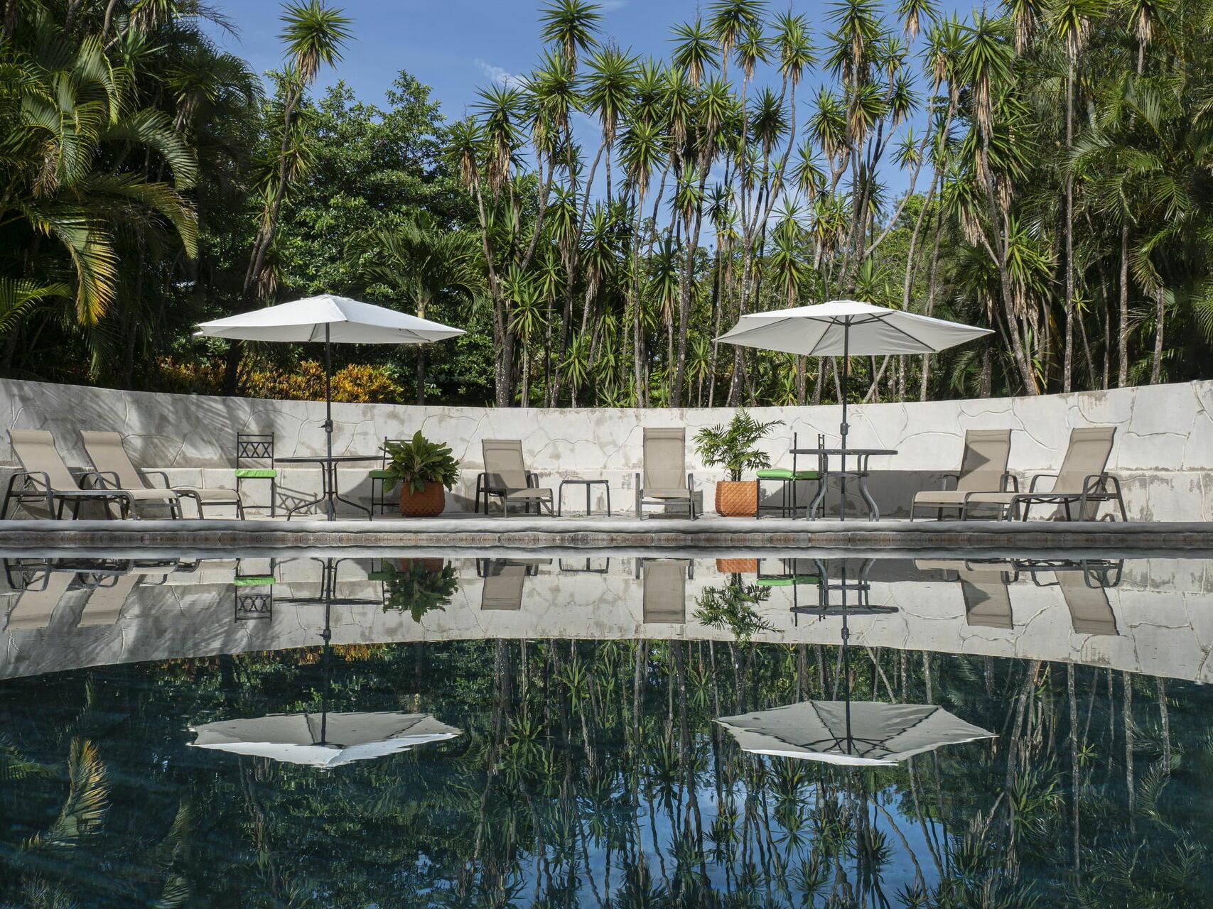 Exterior Pool with Sun Loungers at Buena Vista Del Rincon