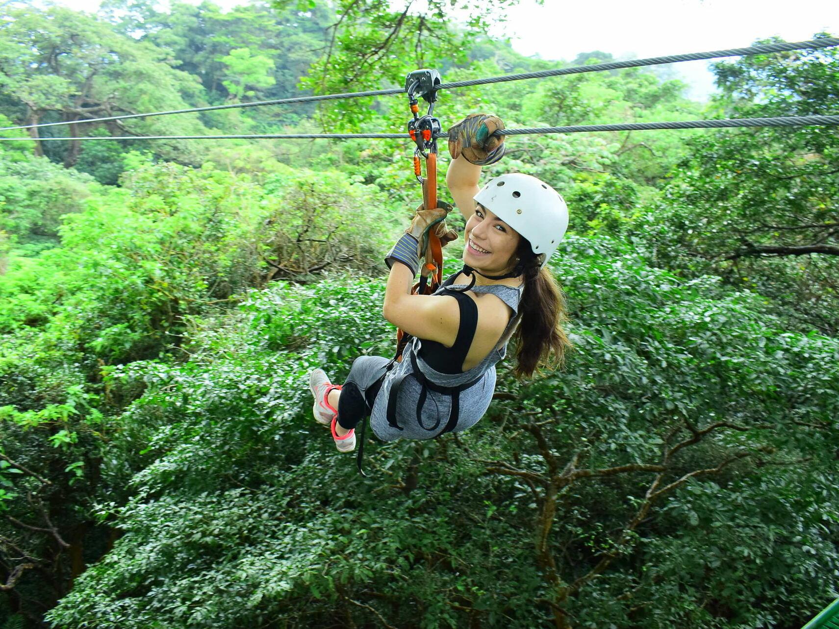 Woman Smiling and Ziplining at Buena Vista Del Rincon