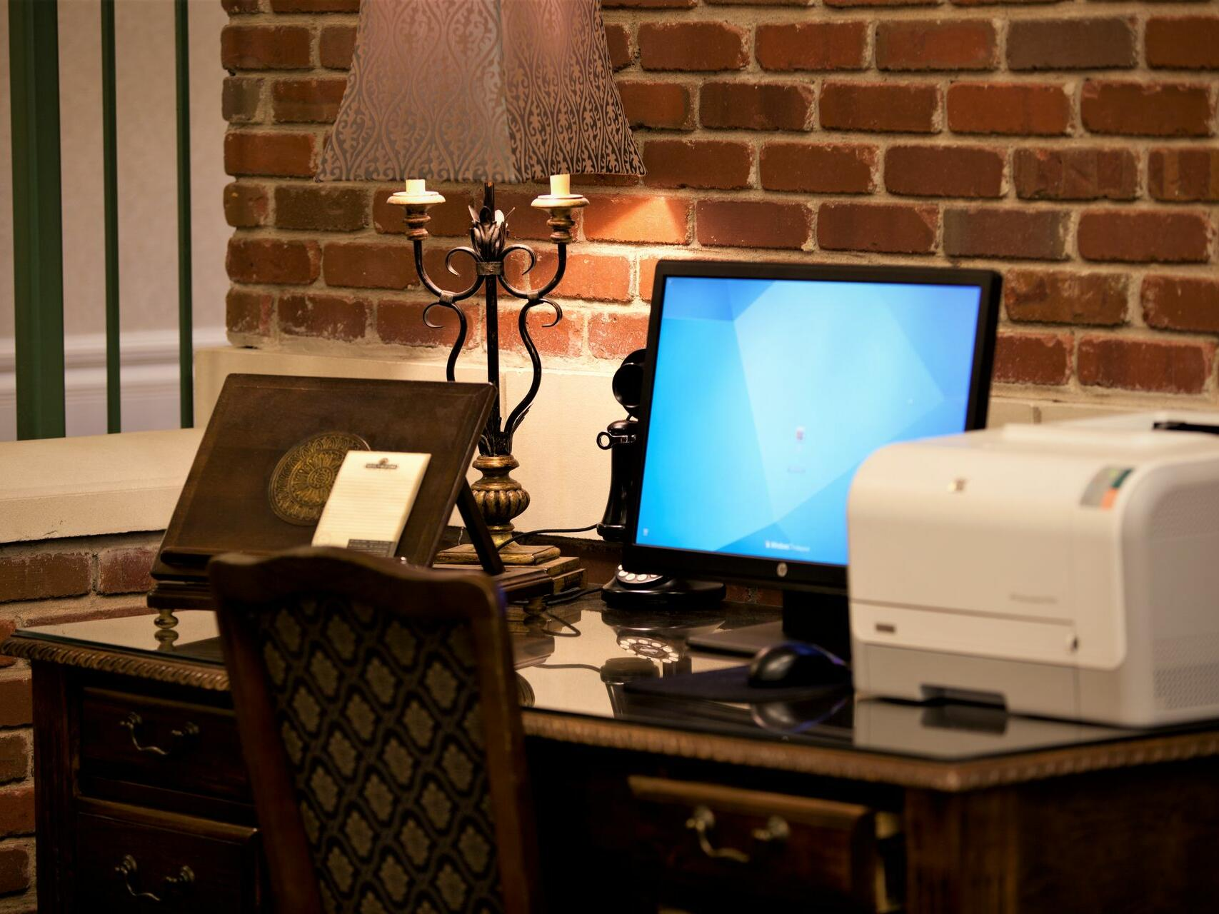 Front desk & the concierge desk at Hotel at Old Town Wichita