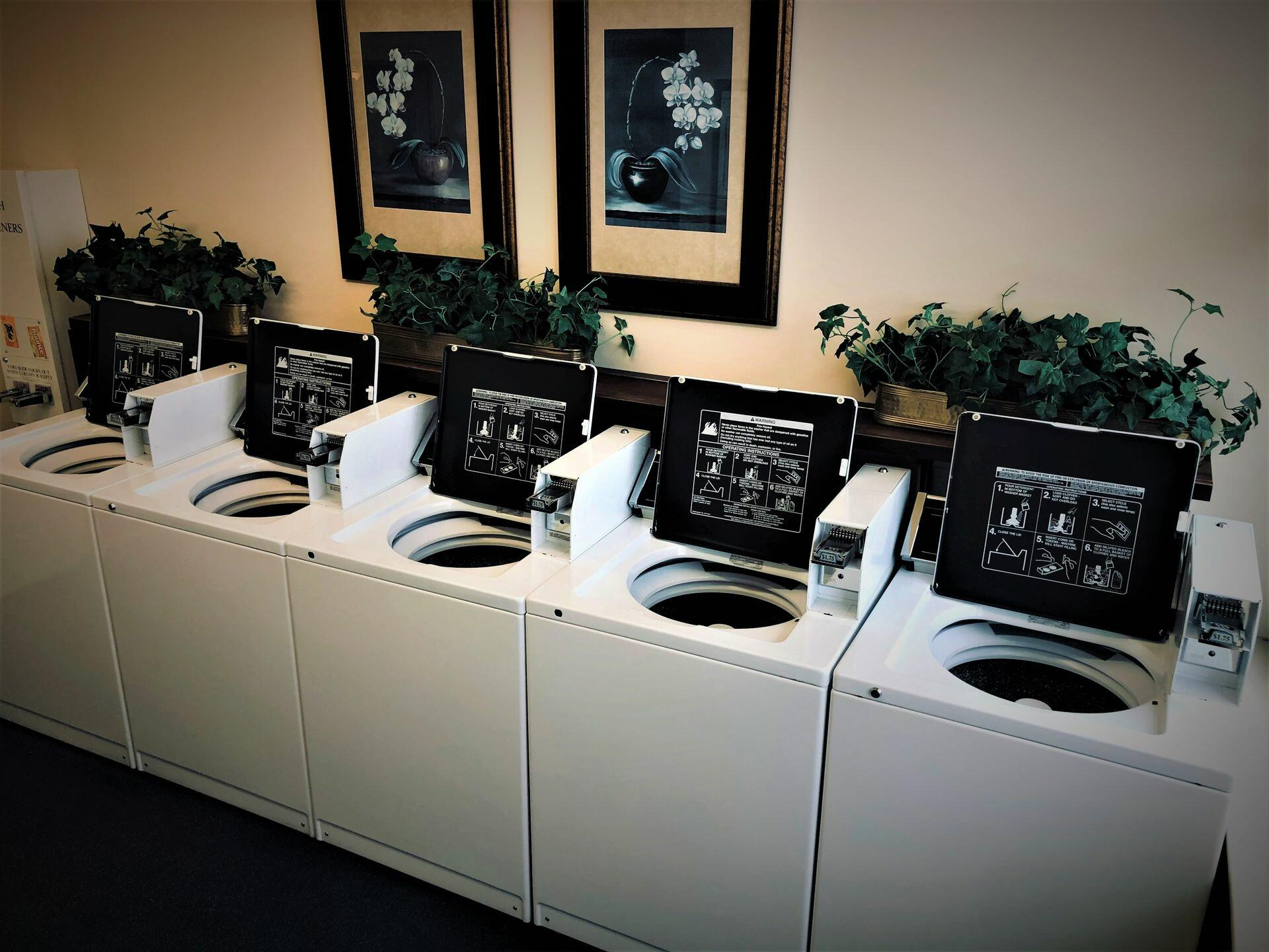 Guest Laundry room with washing machines at Hotel at Old Town
