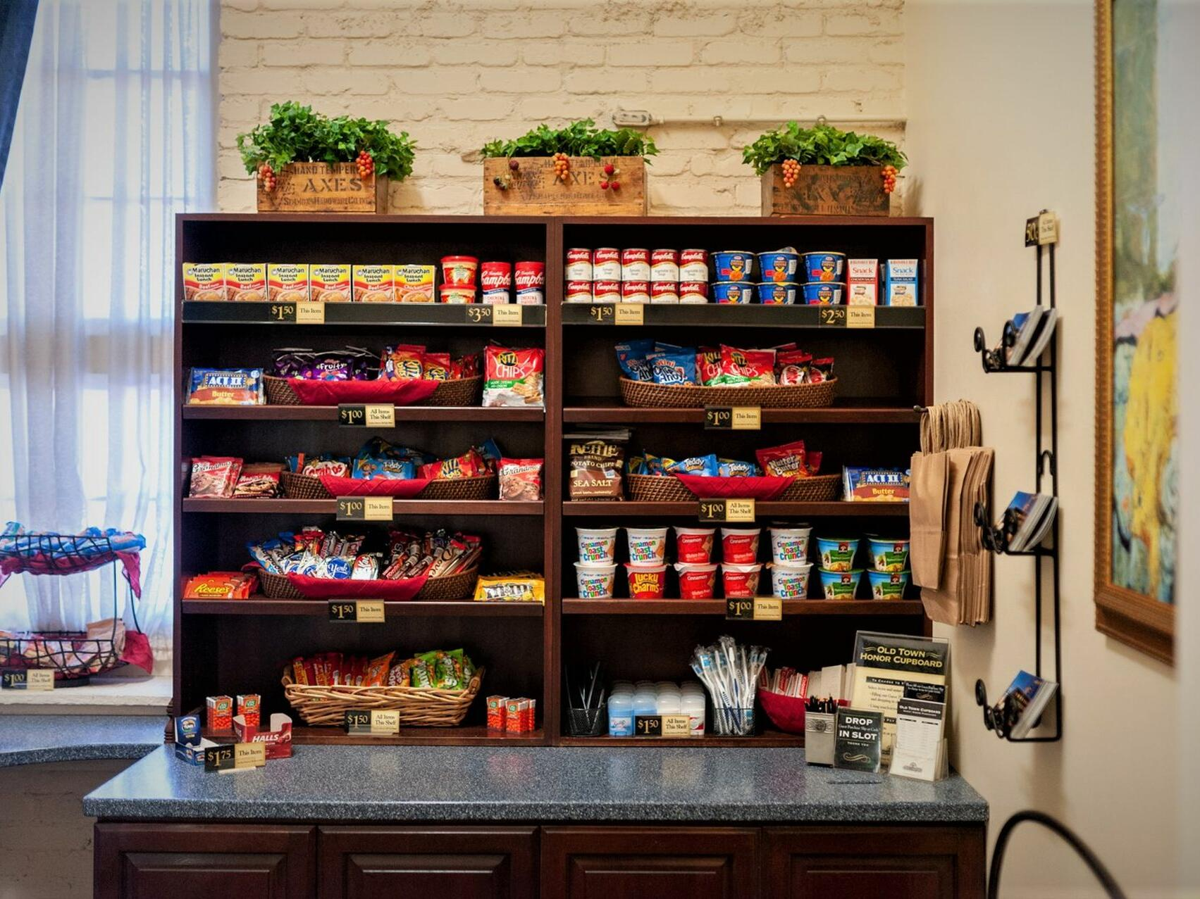 A cupboard filled with snacks & essentials at Hotel at Old Town