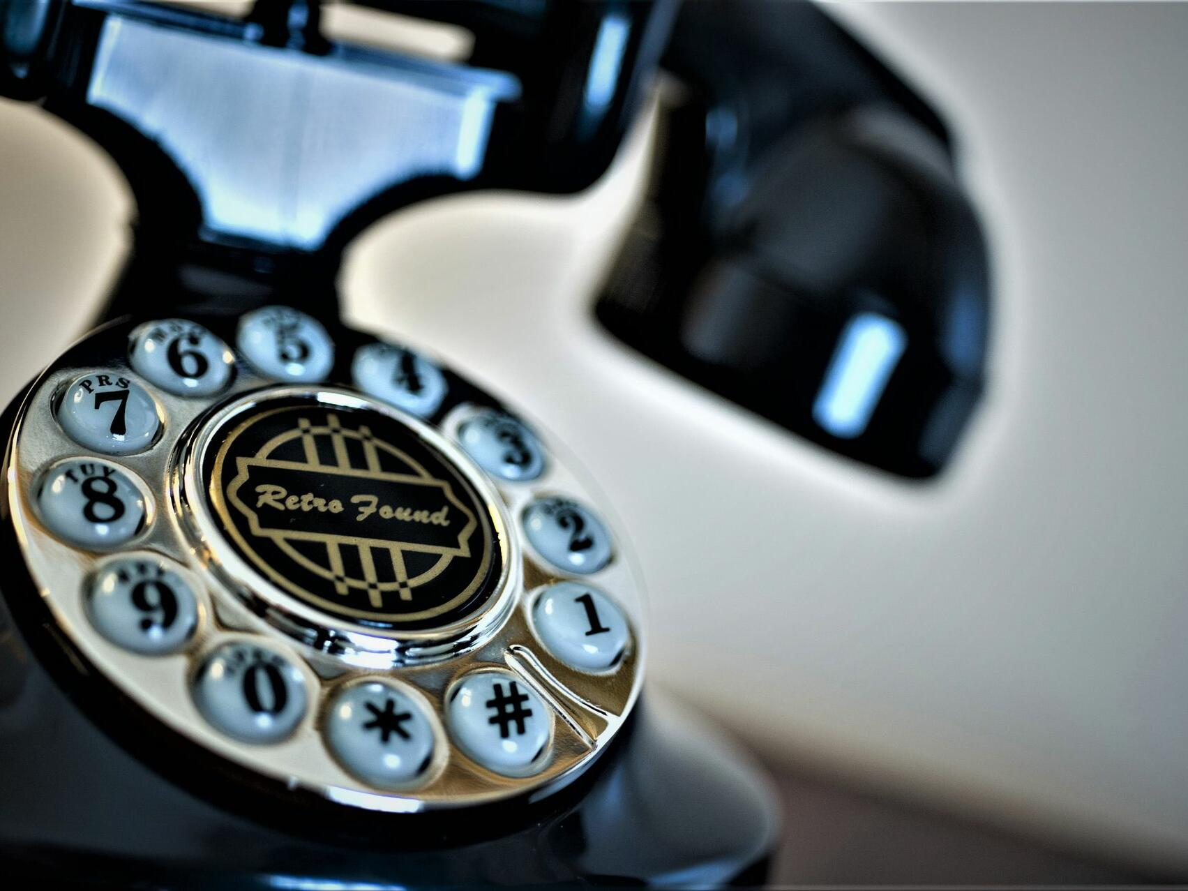 Old telephone on a concierge desk at Hotel at Old Town Wichita