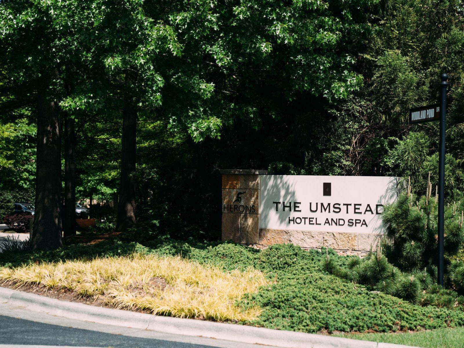 sign that says the umstead hotel and spa