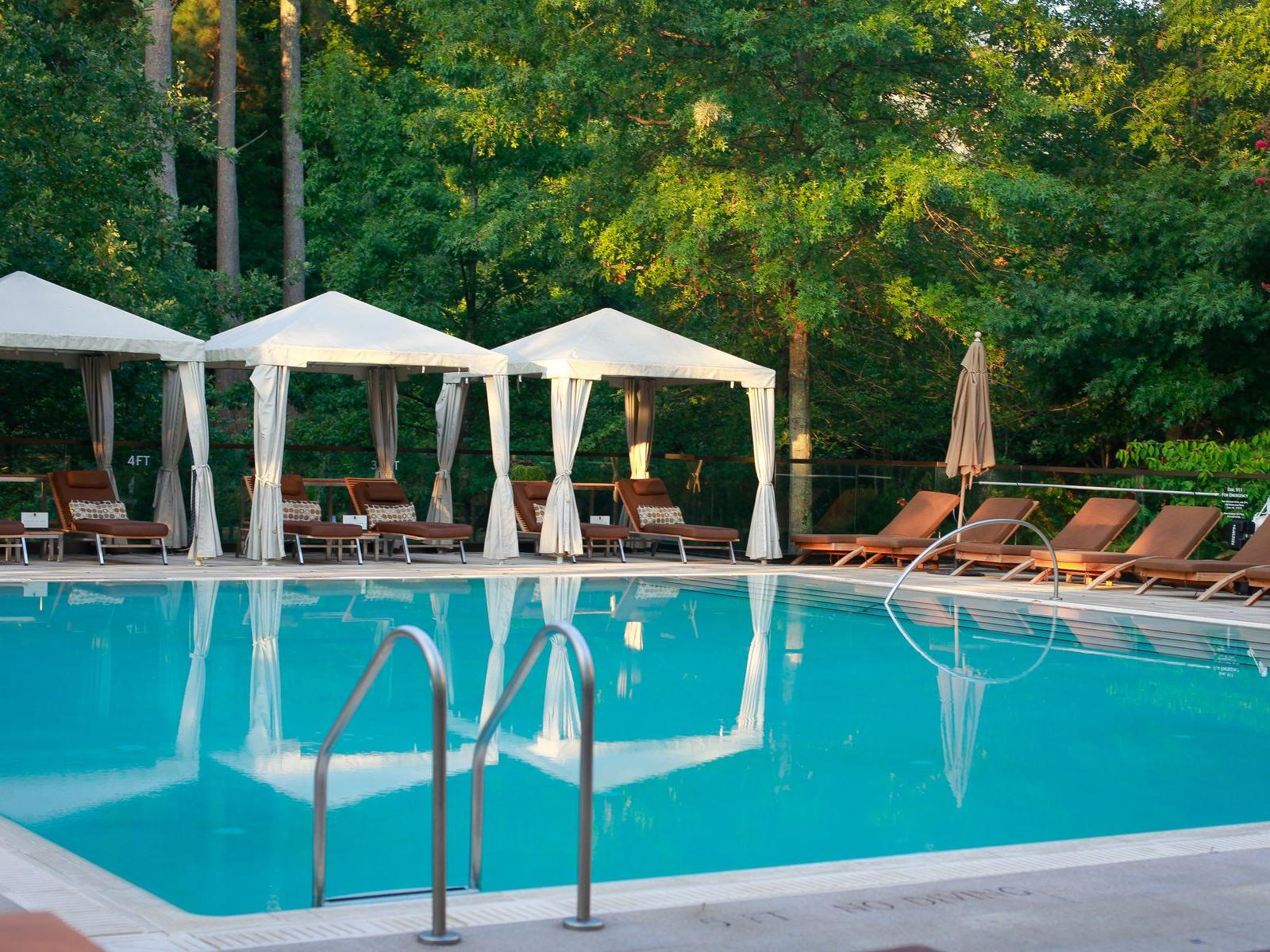 pool with cabana and chairs