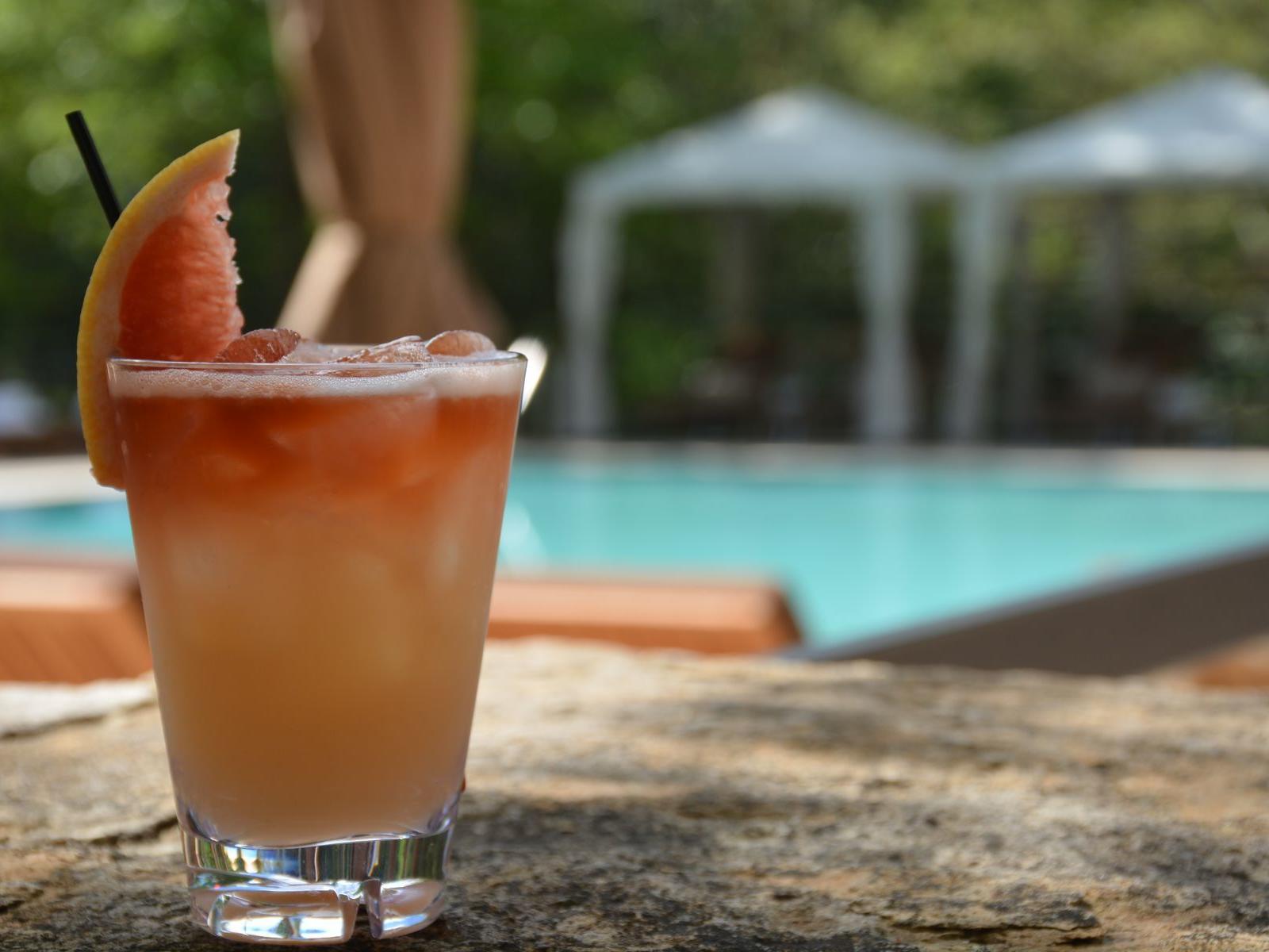 orange cocktail by poolside