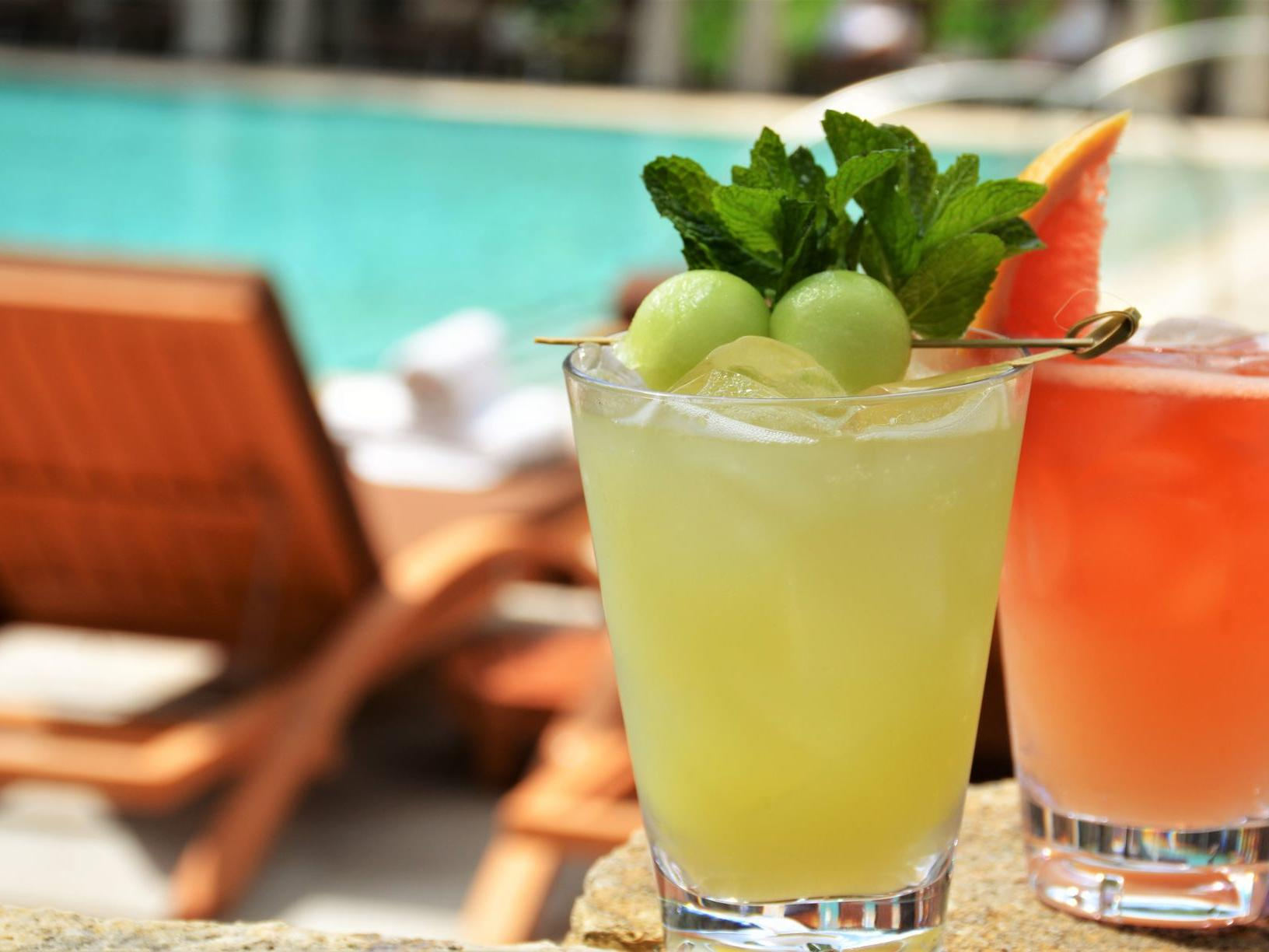 two cocktails by poolside