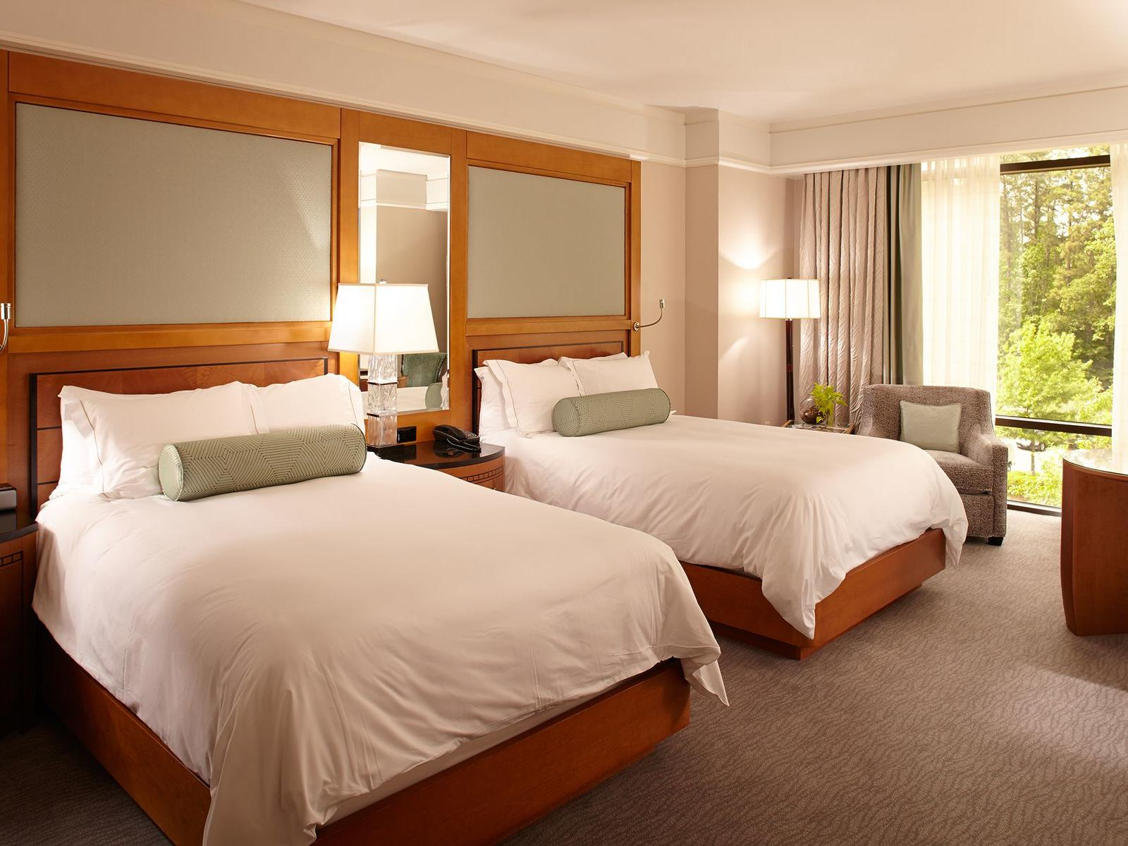 two double beds in hotel room