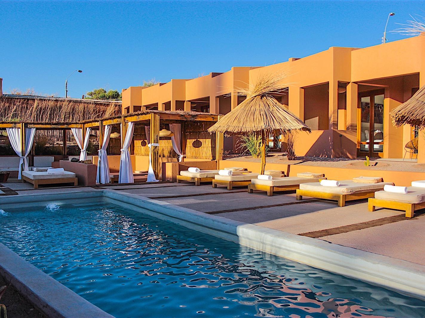 outdoor pool with lounging area at NOI Casa Atacama Hotel