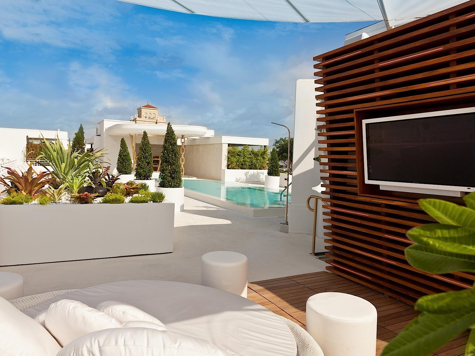 Rooftop cabana with sofa bed & TV at Dream South Beach