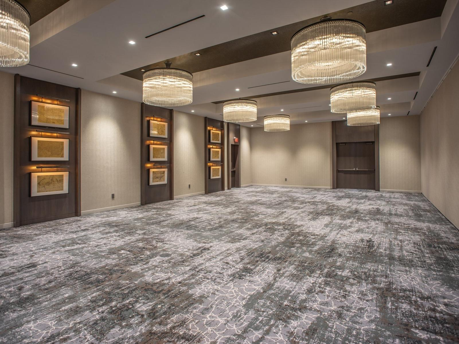 Empty meeting space with decorative chandeliers