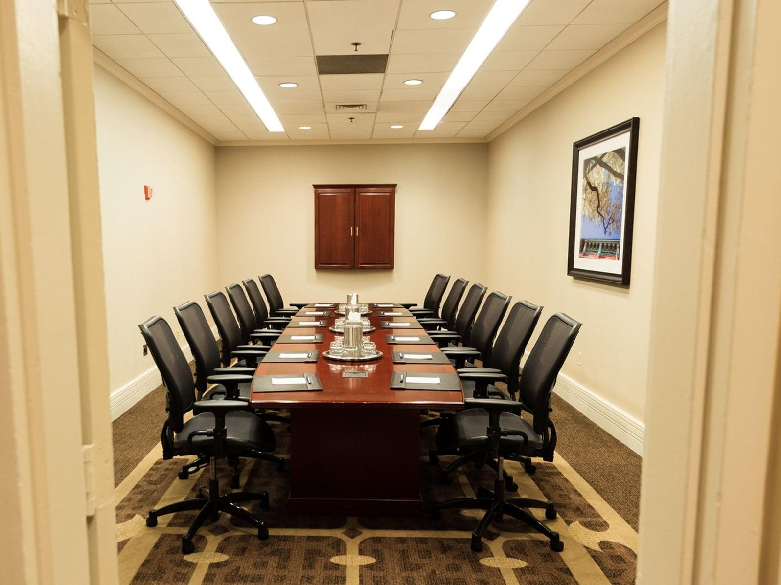 meeting room with conference table and black chairs