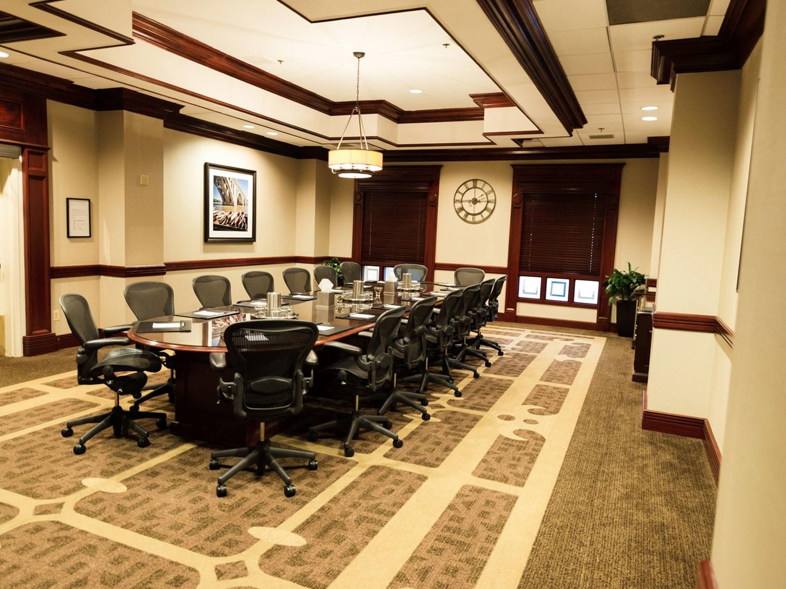 conference table in spacious room with carpet