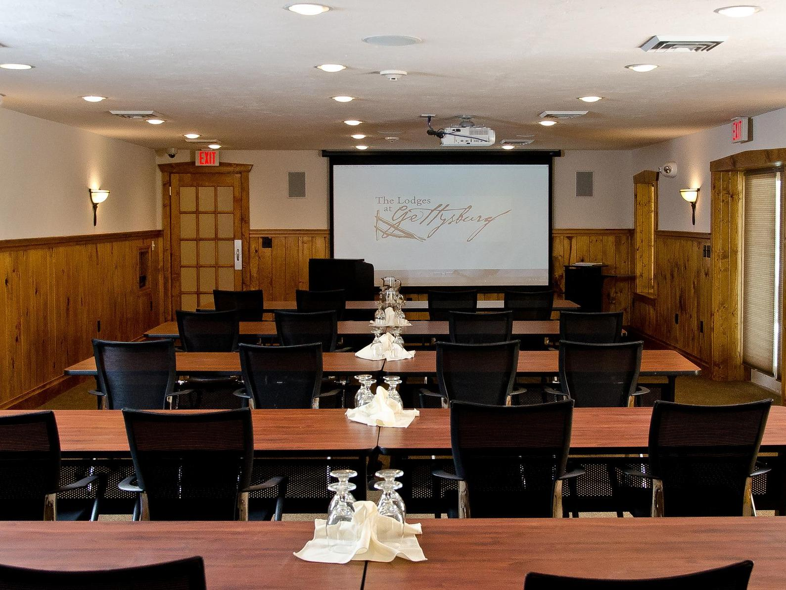 conference room with chairs and screen