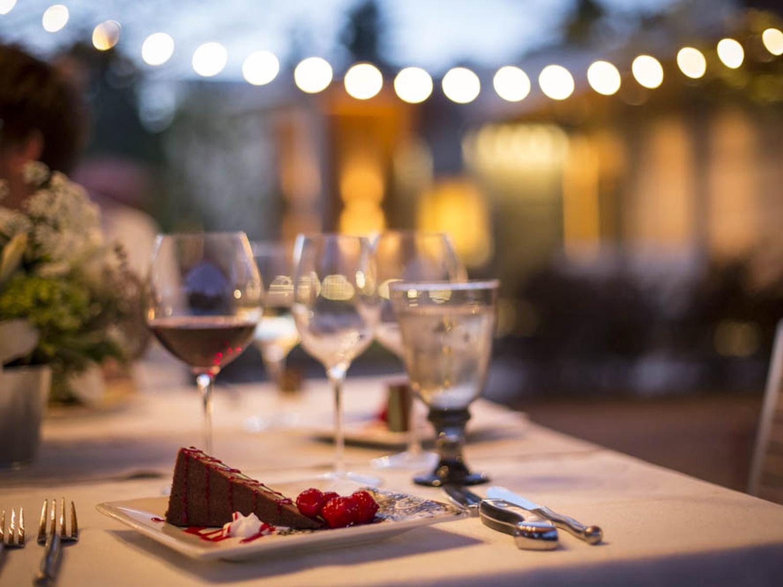 Wedding reception table with market lights in background.