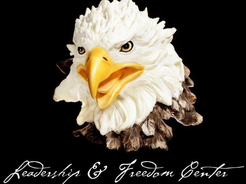 bald eagle with text that says leadership & freedom center