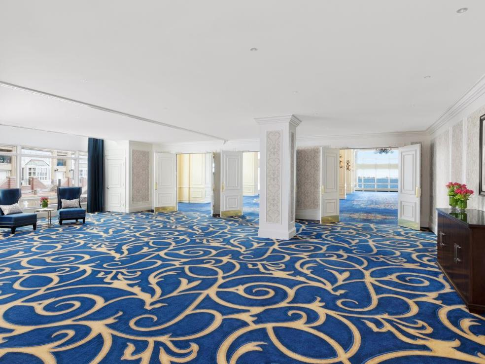 Empty event room with bold patterned carpet