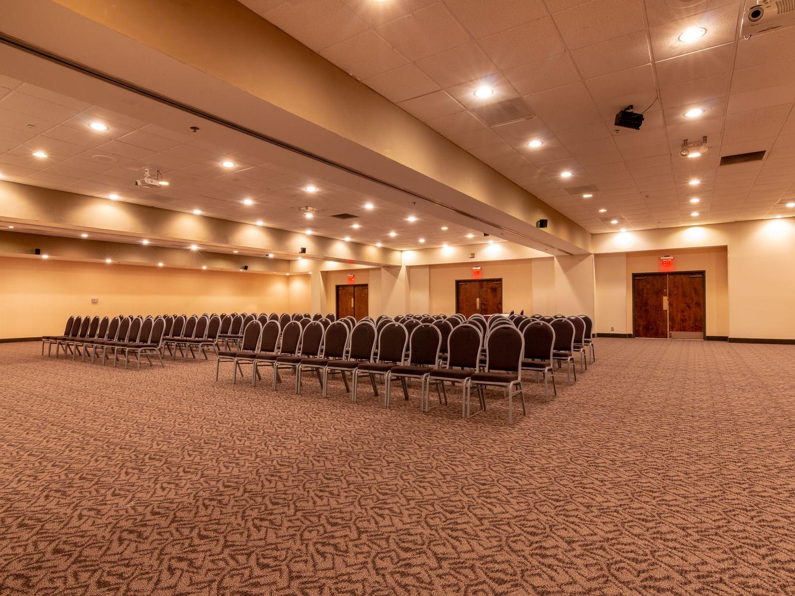 Large ballroom with seating and podium.