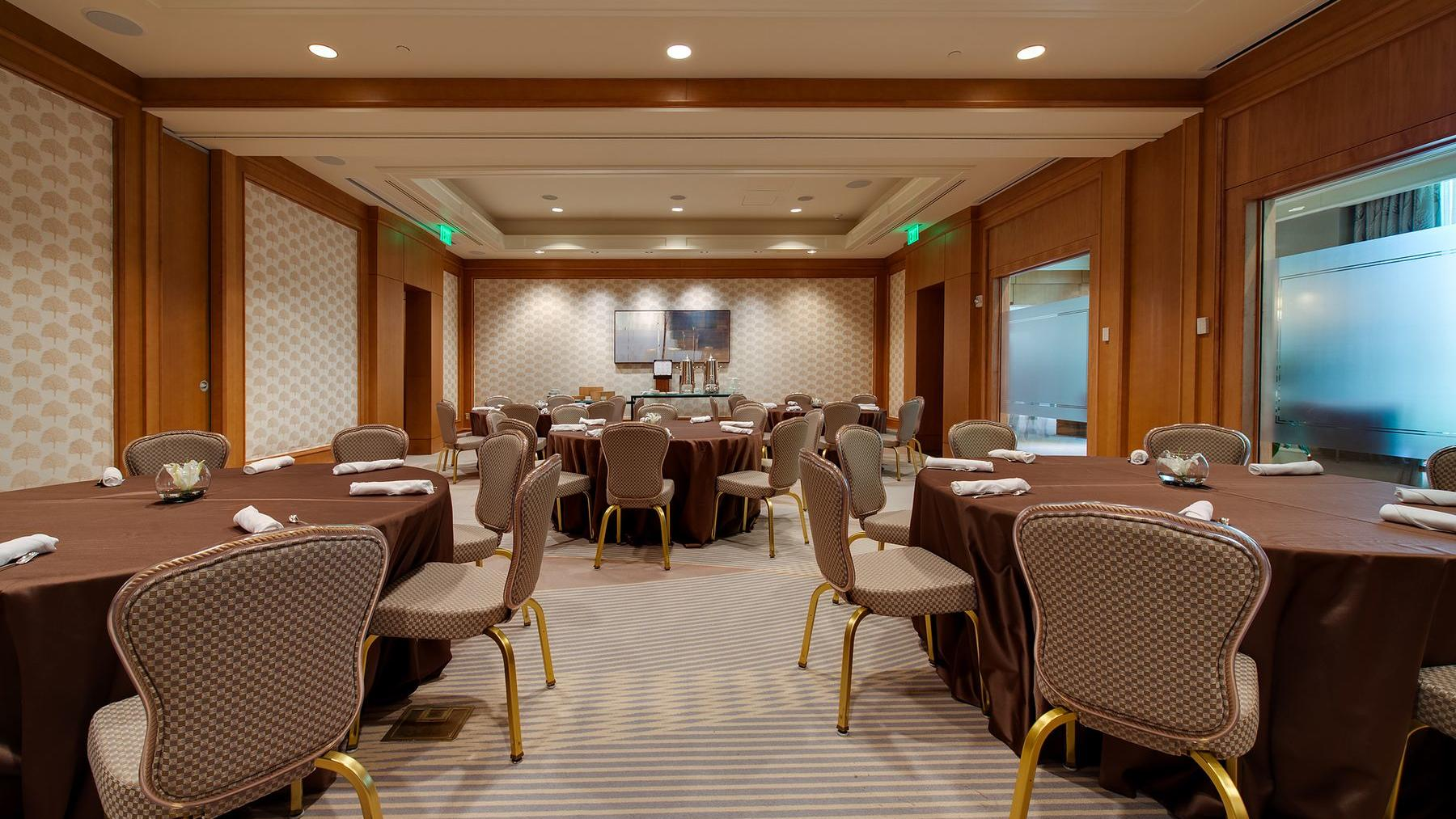 room with round tables and chairs