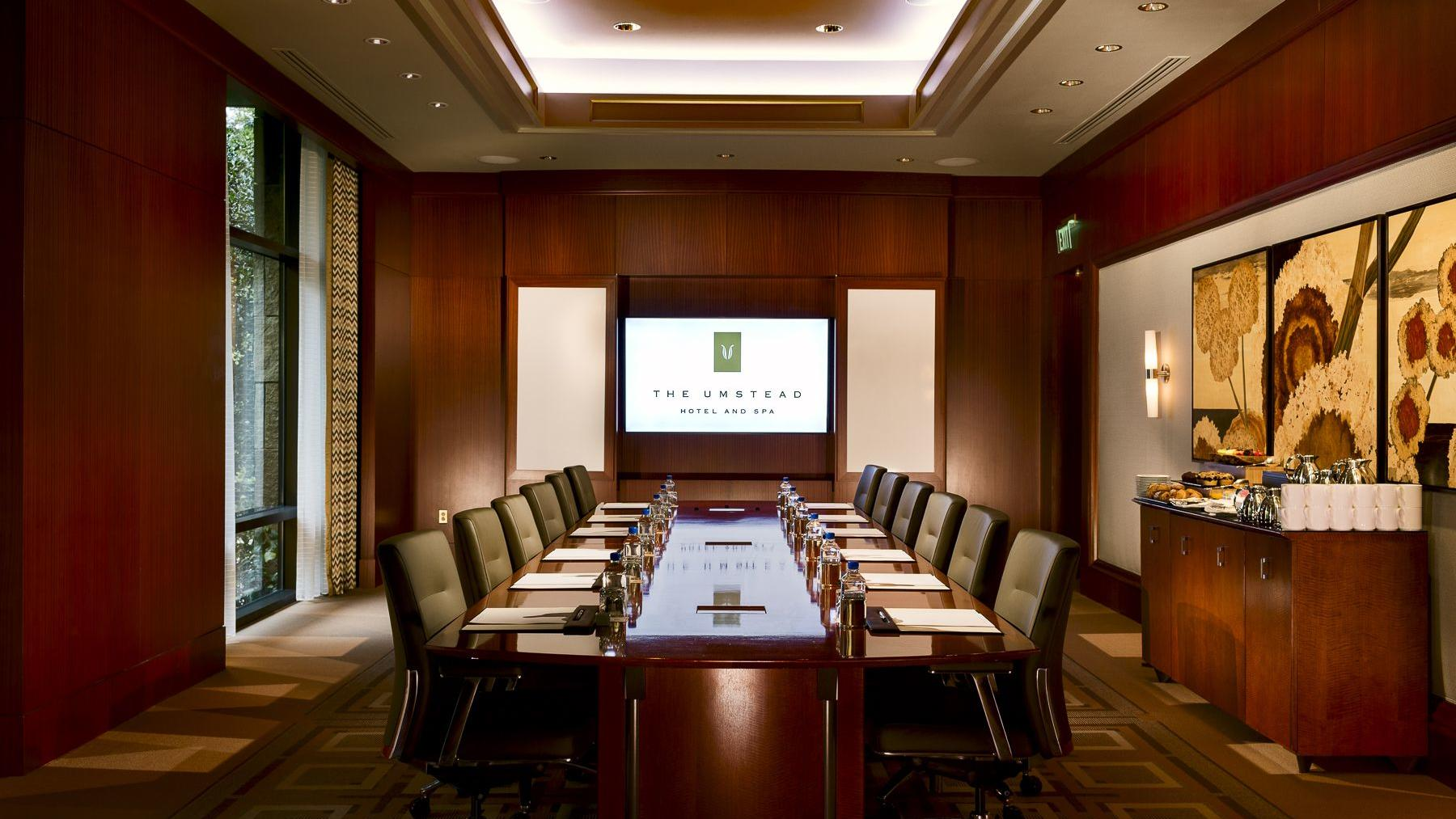 boardroom with long table and chairs