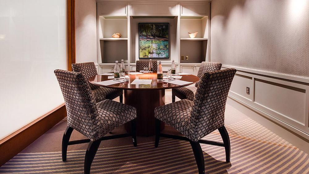 room with round table and chairs